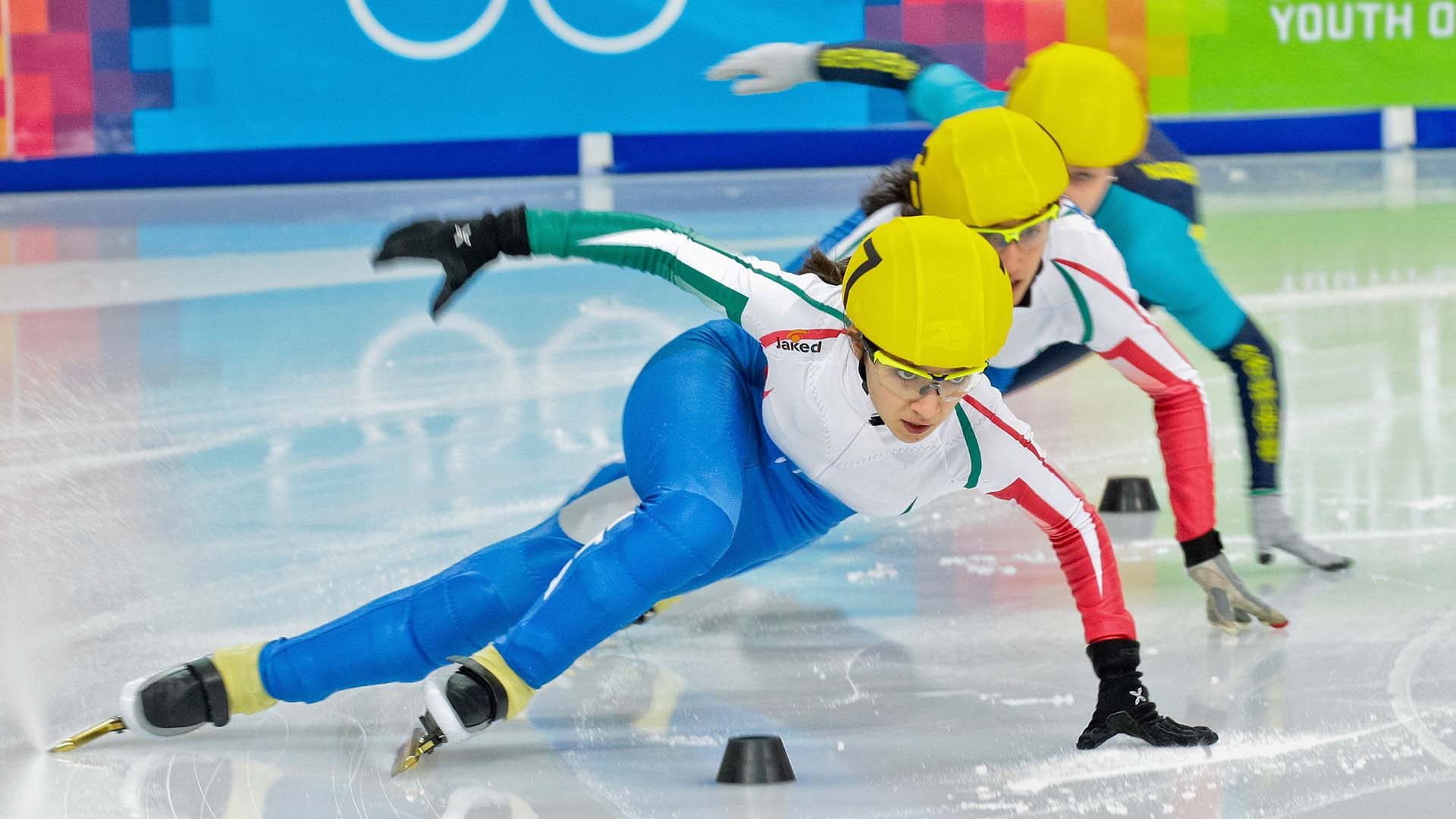 Speed skaters racing in Winter Olympics